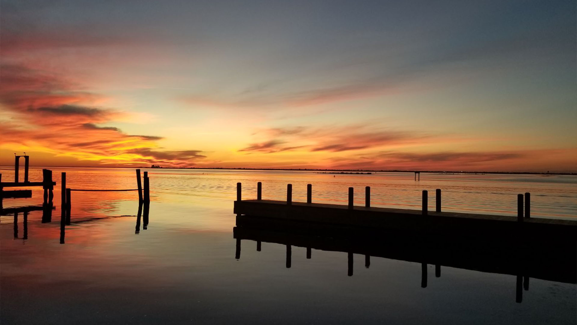 A sunset is pictured from a dock at Doc's Seafood & Steaks